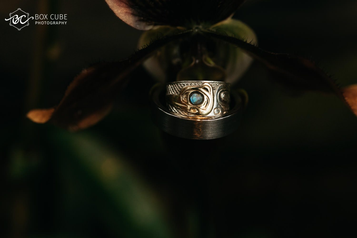 ring shot as the ring is placed inside a flower