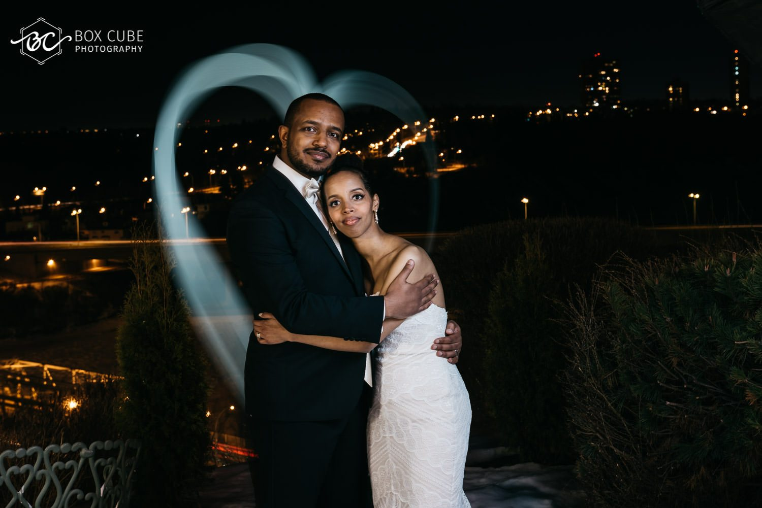 photo of bride and groom overlooking edmonton downtown from hotel fairmont macdonald balcony