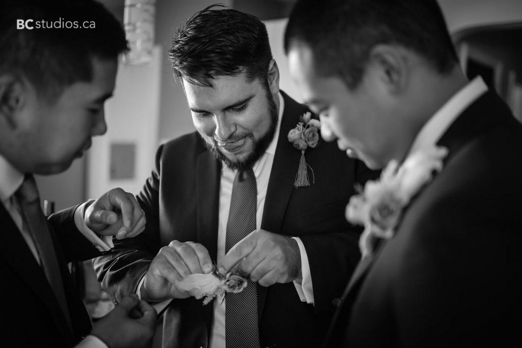 wedding at edmonton oilfield technical society. Groom getting ready.